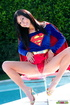 Luscious teen in hot red, blue and yellow Supergirl costume slowly gets