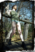 Alluring lady-with-a-twig in a camo shirt and shorts shows off her butthole