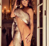 Elegant long haired model posing with fur