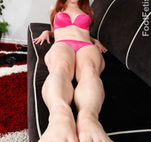 Hot redhead in pink lingerie gets feet licked, gives footsie and fucks