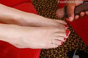 tattooed hottie gets feet