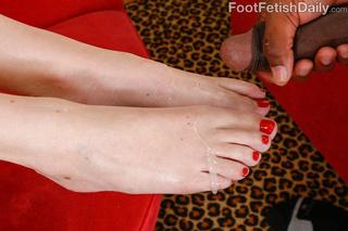 tattooed hottie feet licked