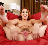 Lusty redhead gives foot job as her toes and pussy gets sucked before