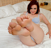 Hairy redhead in blue lingerie sucks dick and gives foot job before hot