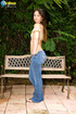 Fantastic dame in a lacy golden top and jeans opens her twat on a bench.