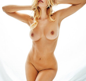 This blonde chick has a huge passion for posing