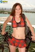 Raunchy bimbo in a plaid sports bra and skirt does a red toy at the balcony.