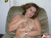 chubby hottie sits gray