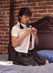 brunette asian schoolgirl getting