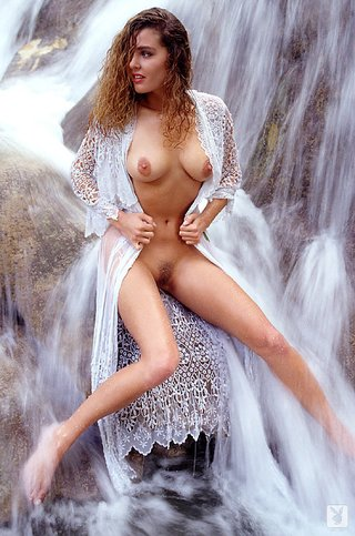 curly haired blonde posing