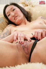 tattooed asian black reveals