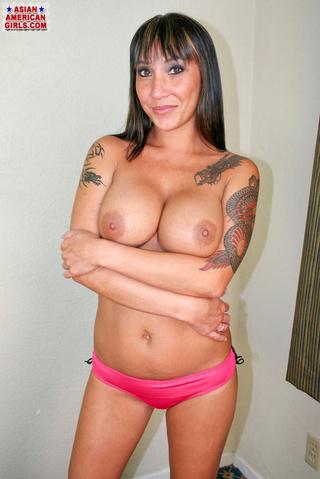 tattooed asian seductress orange