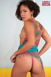 tattooed fresh asian stripped