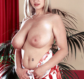 Blonde in red and white dress plays with big tits and nipples and shows