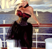 Ravishing busty blonde in sexy black flaunts big inviting boobs on sailing