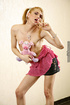 Cute shemale slowly peels off her pink blouse and black skirt and bares