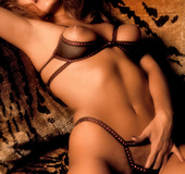 Brown eyed buxom blonde poses sensually and shows off her body