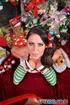 Santa's naughty hazel-eyed elf sucks cock and gets a facial