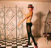 Elegant 50's lady with a hat displays her marvelous body