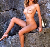 Petite 70's chick posing in a few sexy photos