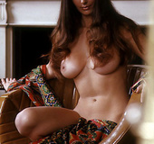 Perfect 70's model with big boobs and a hairy kitty