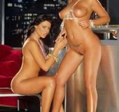 Two dark haired brunettes showing their round boobies