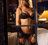 Blonde chick in lingerie showing her big tanned boobs