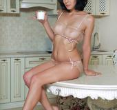 Smoking hot babe displays her stunning body in her skin toned see through