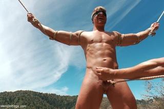 fair-haired naked guy blindfold