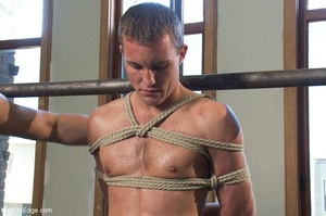 Young stud with a perfect body gets tied - XXX Dessert - Picture 1
