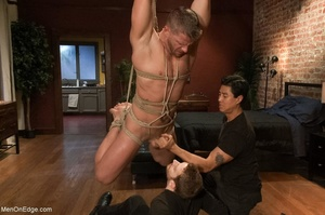 Tied up gay hunk gets used by two horny  - XXX Dessert - Picture 12