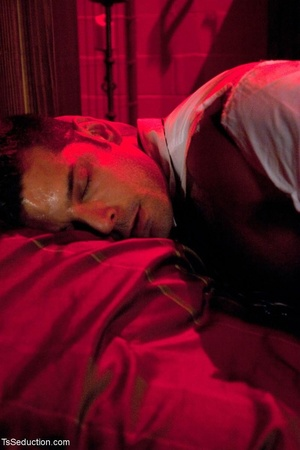 In a room shrouded in red light, a busin - XXX Dessert - Picture 5
