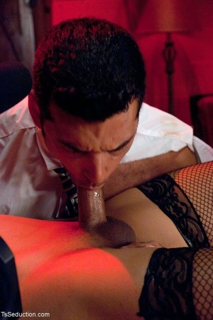 In a room shrouded in red light, a busin - XXX Dessert - Picture 8