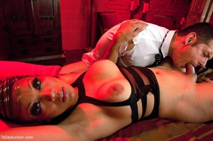 In a room shrouded in red light, a busin - XXX Dessert - Picture 9