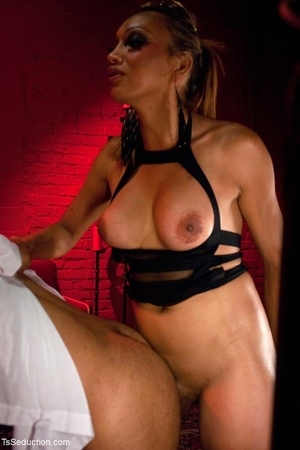 In a room shrouded in red light, a busin - XXX Dessert - Picture 13