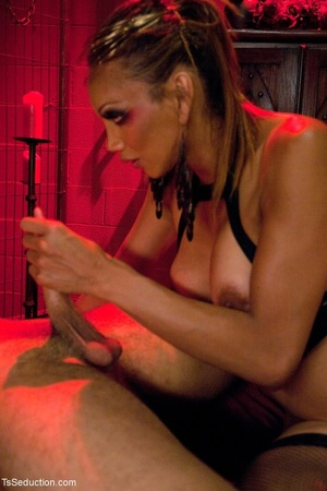 In a room shrouded in red light, a busin - XXX Dessert - Picture 15