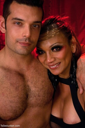 In a room shrouded in red light, a busin - XXX Dessert - Picture 18