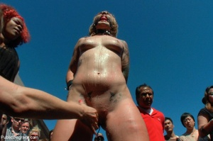 Blonde whore is led around a street fair - XXX Dessert - Picture 5