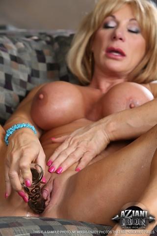 blonde woman flexing muscles