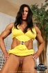 Brunette slut in a yellow outfit toys her smooth twat so hard