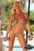 Blonde chick in a bikini showing her big muscles