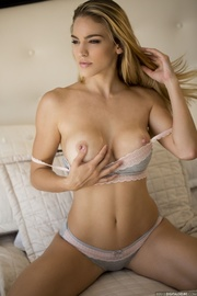 captivating curvy blonde flaunts