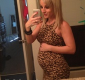 Pregnant blonde pornstar showing off her beautiful belly
