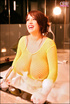 Bombshell rubs soapy suds all over her tits and yellow fishnet top