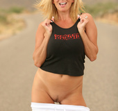 Wild blonde chick posing in the middle of the road
