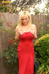 Curvy blonde MILF in red is ready for a outdoors solo session