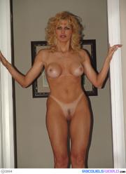 older wife poses lingerie