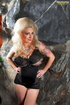 This milf slut tattooed shows us her delicious body in her black lingerie