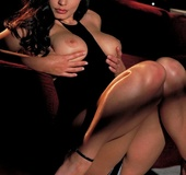 Luxurious brunette seduces in her little black dress by passionate red