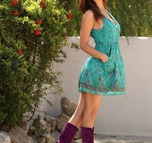 Wonderful tall redhead in lovely dress poses outdoors and flashes black